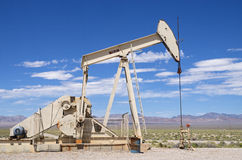 Desert Oil Well. Pump jack in Nevada royalty free stock photos