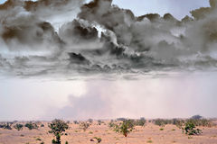 Desert outside the city with black smoke. In the panoramic view in the Middle East Stock Image