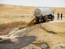 21.05.2017, Desert outside Kawergosk Camp, Iraq.: A Sewage truck is dumping its Load outside the Kawergosk Refugee Camp in stock photos