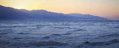 Desert Panorama. A panoramic view of Bad Water Basin in Death Valley National Park in California at sunset Royalty Free Stock Image