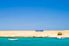 Desert paradise. Paradise sign in the desert Royalty Free Stock Photo