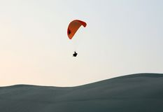 Desert paragliding Royalty Free Stock Photo