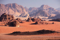 Desert plain. Sandy plain with surrounding mountains in the Wadi Rum desert, Jordan Stock Photos