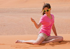 Desert Play. A teen plays with sand while visiting the desert Royalty Free Stock Photos