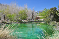 Desert Pond. A ranger station sits at the edge of a large pond at Whitewater Canyon Preserve near the desert town of Palm Springs, California Royalty Free Stock Images