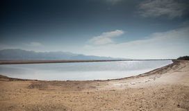 Desert pond. Desert at winter, water pond with clouds formation Royalty Free Stock Image
