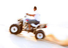 Desert quad bike action blur Royalty Free Stock Photos