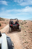 Desert quad riding Stock Images