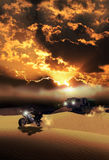 Desert race. Moto rider and truck driver, in competition in a motor race through the desert Stock Image