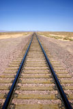 Desert Railroad. A railroad line tails away into the vast Mojave Desert of southern California royalty free stock image