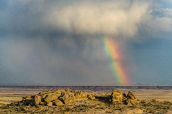 Desert Rainbow. A vibrant rainbow in the wyoming desert after a thunderstorm Royalty Free Stock Photos