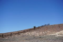Desert ranchland with wooden fence royalty free stock photo