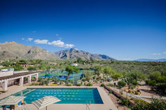 Desert Resort - Tucson, AZ. Olympic size pool and tennis courts at beautiful resort with view of Rincon Mountains near Saguaro National Park and Tucson, Arizona royalty free stock photography