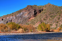 Desert River. A river flowing through the desert mountains Royalty Free Stock Photos