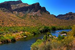 Desert River. River in the winter Arizona desert mountains with a fisherman Royalty Free Stock Images
