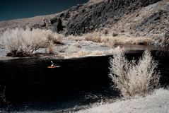 Desert River Kayak. Boater on river in the winter Arizona desert mountains Stock Photography