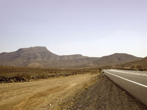 Desert road. And volcanic mountains Royalty Free Stock Photo