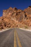 Desert road. Long stretch of desert road Stock Photos