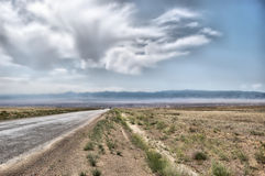 Desert road. Blue sky Royalty Free Stock Images