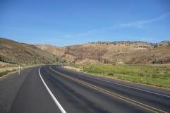 Desert road. A quiet desert road in Oregon stock photography