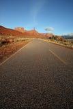 Desert road. A road in the desert near moab in castle valley utah stock images