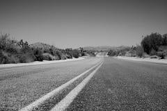 Desert Road. A road through the desert near Joshua Tree, California Royalty Free Stock Image