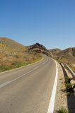 Desert road. Winding uphill across Cabo de Gata natural park, Almeria, Spain royalty free stock images