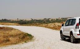 Desert road. Off-road car in desert Royalty Free Stock Photography
