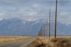 Desert road. Long desert road leading to the mountains Stock Photography