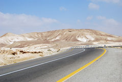 Desert road. Desert highway on the way to Dead Sea, Israel Royalty Free Stock Photos