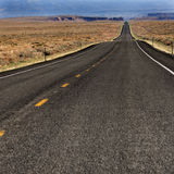 Desert Road. A road in the southwest USA spans across the hot desert Royalty Free Stock Photo