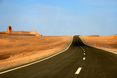 Desert Road. Road through hot remote iranian desert Middle East Royalty Free Stock Photos