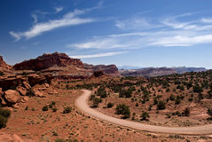 Desert Road: American Southwest. A road near Capital Reef Utah, USA winds through the warm desert Royalty Free Stock Images