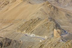 A desert road and ancient fort ruins stock image