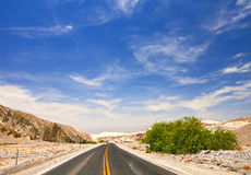 Desert road and blue sky in Death Valley national park Stock Photos