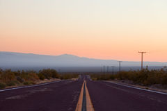 Desert road in Death Valley National Park, Royalty Free Stock Images
