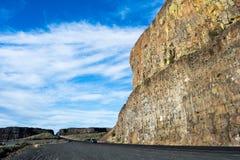 Desert road in eastern Washington state, USA. Scenic desert road running along basalt rock formations near Grand Coulee in Eastern Washington state, USA Stock Photo