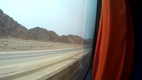 Desert in Egypt view from bus. Desert road in Egypt view from bus stock footage