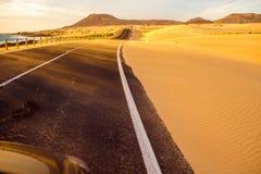 Desert road on Fuerteventura island Royalty Free Stock Photos