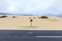 Desert Road in Fuerteventura with parking forbidden sign in the Stock Images