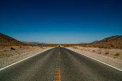 Desert road highway in death valley national park Royalty Free Stock Photography
