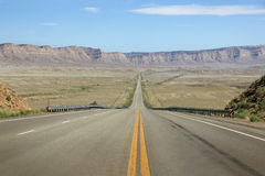Desert road. Highway USA with mountains in de background Stock Photo