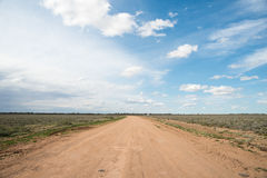 Desert Road. This image is a desert road in which has lineal perspective, which draws the audiences eye into the image Royalty Free Stock Photo