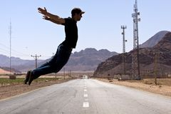 Desert road - jumping scene Stock Image