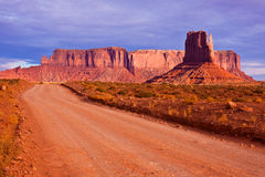 Desert Road in Monument Valley. Road between the buttes of Monument Valley Navajo Tribal Park, Arizona Royalty Free Stock Photography