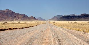 Desert Road through the Mountains Stock Photos