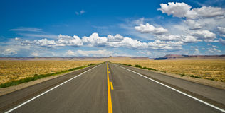 Desert road near the Four Corners area in the USA. Stock Images