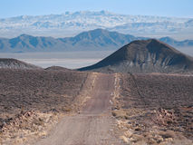 Desert road in northern Nevada. Road passes through the northern Nevada desert near the ghost town of Rawhide Royalty Free Stock Image