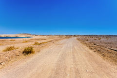A desert road. Royalty Free Stock Photo