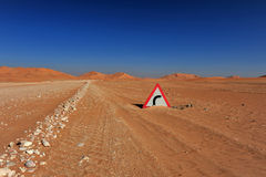 Desert and road sign Stock Photos
